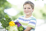 Portrait of a boy with bowl of mixed vegetables - ZEF002758