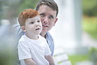 Red-haired boy with father outside - ZEF003460