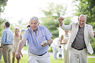 Two happy men playing boules in park - ZEF003483