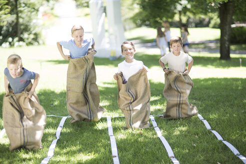 Boys competing in a sack race - ZEF002793