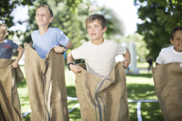 Boys competing in a sack race - ZEF002795