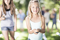 Girl competing in an egg-and-spoon race - ZEF002811
