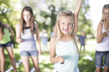 Girl winning in an egg-and-spoon race - ZEF002812
