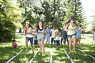 Girls competing in an egg-and-spoon race - ZEF002815