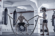Man doing fitness training with ropes - ZEF002620