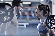 Man and woman doing fitness training with weights - ZEF002630