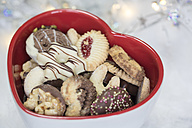 Heart-shaped bowl of different Christmas Cookies - SARF001144