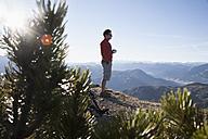Austria, Tyrol, Unterberghorn, hiker at sunrise - RBF002094