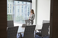 Businesswoman standing in conference room - RBF002107