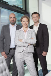 Portrait of confident businesswoman and businessmen in office - RBF002153