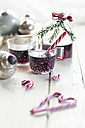 Glasses of mulled wine, candy canes and Christmas decoration - SBDF002164