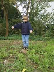 Boy balancing on stone - ZM000356