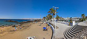 Spain, Canary Islands, Lanzarote, beach at Puerto del Carmen - AMF003437