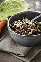 Bowl of beluga lentil stew with savoy, tomatoes and carrots - EVGF001037