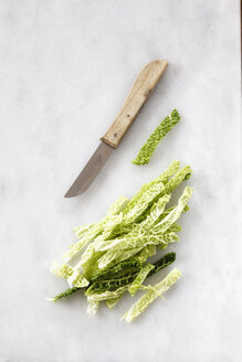 Chopped savoy and a kitchen knife on white marble - EVGF001042
