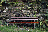 Bench in front of  natural stone wall - DWF000210
