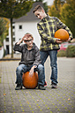 Two boys with two big pumpkins - PAF001093