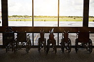 USA, Hawaii, row of parked wheelchairs at the airport - STK001098