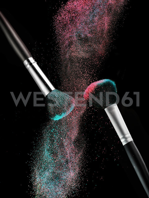 Coloured make-up powder and two beauty brushes in front of black background - RAMF000032