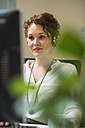 Young woman in office wearing headset - UUF002913