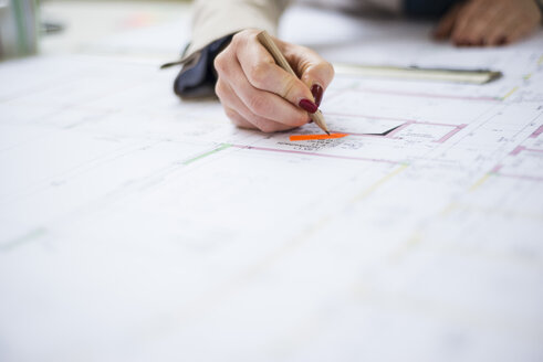 Close-up of architect working on construction plan - UUF002930