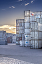 Germany, Hamburg, Stacked shipping containers at harbour - NKF000213