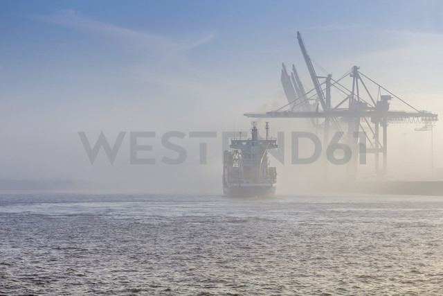 Germany, Hamburg, container ship disapears in the dense fog in the port of Hamburg - NK000224 - Stefan Kunert/Westend61