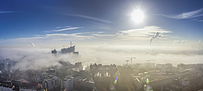 Germany, Hamburg, Elbphilharmonie and port sticking out of dense fog - NKF000226