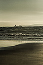 Spain, Andalusia, Tarifa, Freight ship in front of coast - KB000261