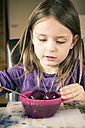 Little girl dyeing Easter eggs - SARF001184