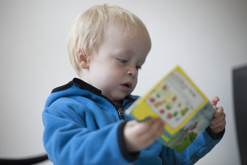 Concentrated little boy with children's book - RBF002201