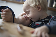 Two little brothers cuddling at home - RB002204