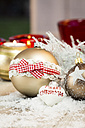 Different Christmas baubles and artifical snow - JUNF000120
