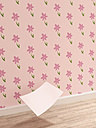 Blank sheet of paper falling down to wooden floor in front of pink wallpaper with floral design, 3D Rendering - UWF000285