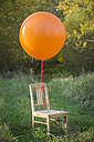 Chair with balloon on meadow - JTLF000017