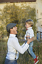 Happy father and son outdoors - JTLF000006