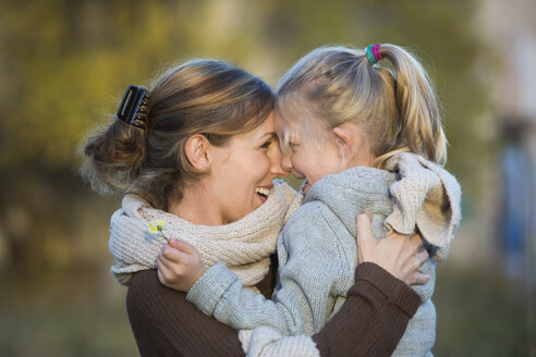 Laughing mother and daughter outdoors - JTLF000004