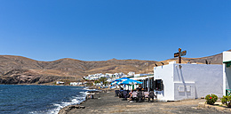 Spain, Canary Islands, Lanzarote, Puerto Calero, seaside cafe at Playa Quemada - AM003479