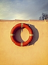 Spain, Majorca, rescue ring with shadow, hanging on a wall - MS004398