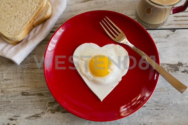 Heart-shaped fried egg on red plate - SARF001189