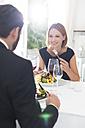 Elegant couple having dinner in restaurant - WESTF020421