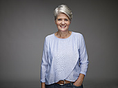 Portrait of mature woman with grey hair in front of grey background - RH000461
