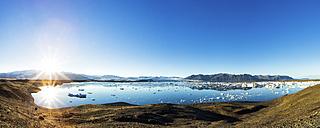 Iceland, Austurland, Joekulsarlon, Glacier lagoon against the sun, Panorama - STSF000660