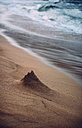Spain, Balearic Islands, Menorca, a castle made of sand destroyed by the waves - EHF000002