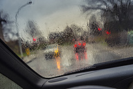 Germany, Grevenbroich, View through windscreen at crossroad at rainy wetter - FRF000161