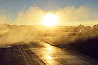 USA, Hawaii, Big Island, Volcanoes National Park, sulfur vapor over lane in morning twilight at Steaming Bluff - BRF000919