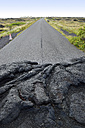 USA, Hawaii, Big Island, Volcanoes National Park, congealed lava on the lane of Chain of Craters Road - BRF000942