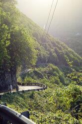 USA, Hawaii, Big Island, Waipio Valley, two hikers walking at evening light - BR000978