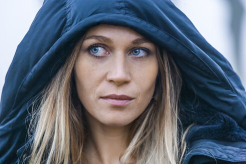 Portrait of blond woman with blue hood - TCF004497
