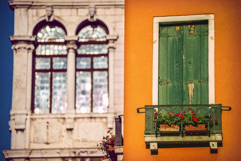 Italy, Venice, house facade with closed shutters and palazzo in the background - EHF000043